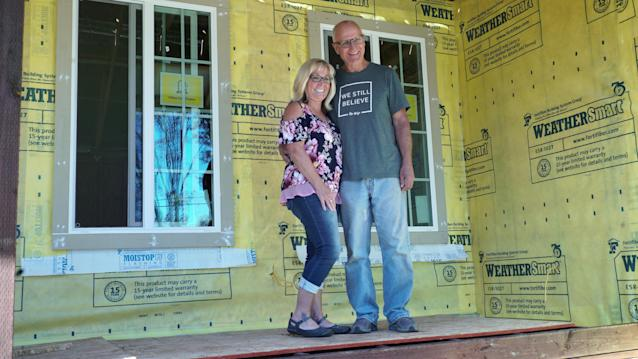 Jo Lynne and Bert Clement in front of their newly under-construction home. (Photo: Henry Keyser/Yahoo News)