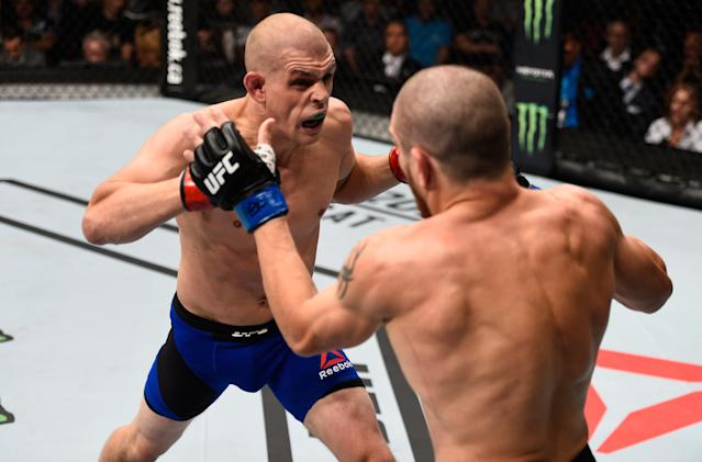 After careful consideration, Joe Lauzon (L) has decided to charge back into competition. (Jeff Bottari/Zuffa LLC/Zuffa LLC via Getty Images)