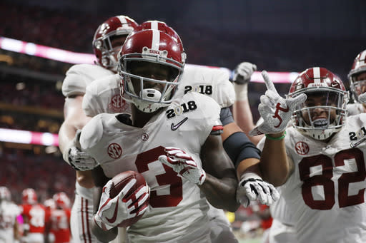 "Alabama's <a class=""link rapid-noclick-resp"" href=""/ncaaf/players/257021/"" data-ylk=""slk:Calvin Ridley"">Calvin Ridley</a> celebrates his touchdown catch during the second half of the NCAA college football playoff championship game against Georgia Monday, Jan. 8, 2018, in Atlanta. (AP Photo/David Goldman)"