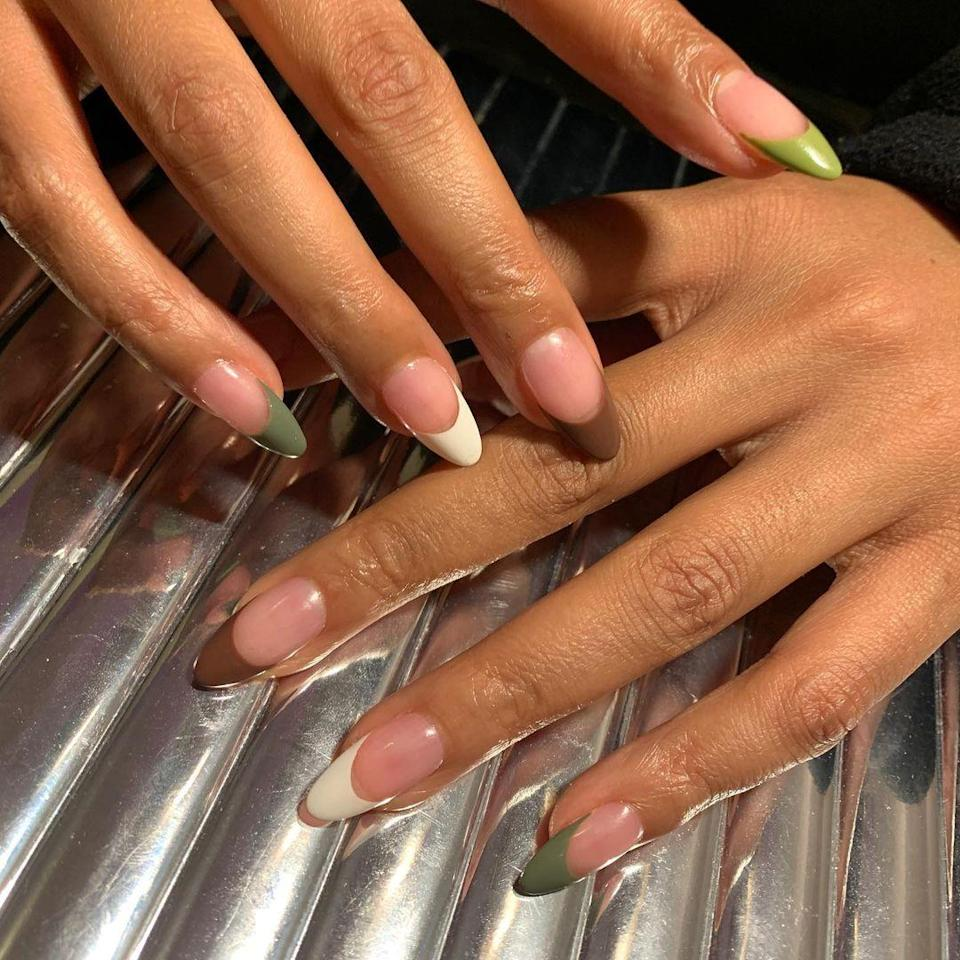 For a super-subtle take on holiday nails, try French tips with a hint of green. Throwing in some white and brown keeps it cool and unexpected.