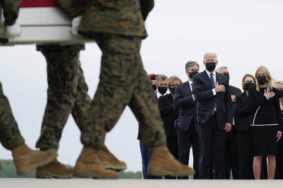 President Joe Biden and first lady Jill Biden watch as a carry team moves a transfer case containing the remains of Marine Corps Lance Cpl. Kareem M. Nikoui, 20, of Norco, Calif., during a casualty return Sunday, Aug. 29, 2021, at Dover Air Force Base, Del. According to the Department of Defense, Nikoui died in an attack at Afghanistan's Kabul airport, along with 12 other U.S. service members. (AP Photo/Carolyn Kaster)
