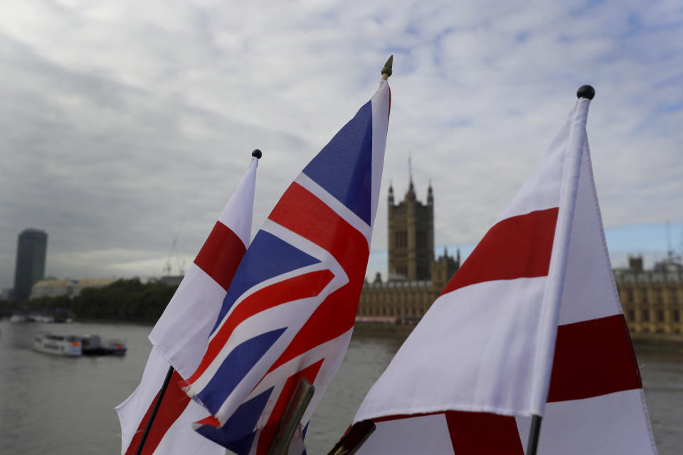 """English flags and a Union flag fly above a souvenir stand opposite Britain's Parliament in London, Friday, Oct. 16, 2020. Britain's foreign minister says there are only narrow differences remaining in trade talks between the U.K. and the European Union. But Dominic Raab insists the bloc must show more """"flexibility"""" if it wants to make a deal. (AP Photo/Kirsty Wigglesworth)"""