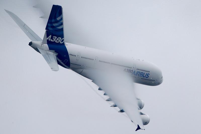 An Airbus A380, the world's largest jetliner, generates vortex during a flying display at the 51st Paris Air Show at Le Bourget airport near Paris