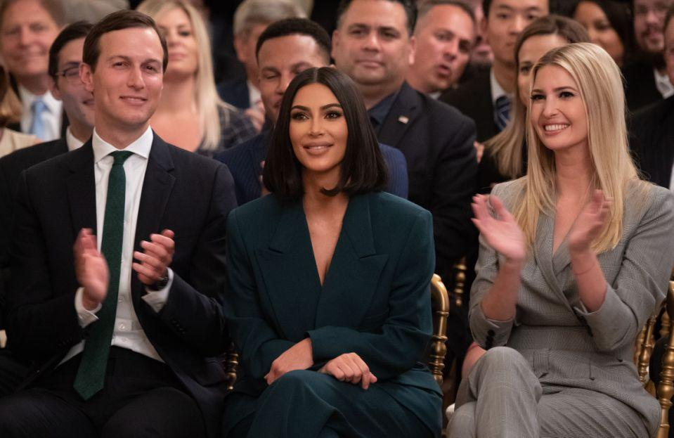 Kim Kardashian(C), Ivanka Trump(R) and Jared Kushner applaud as US President Donald Trump