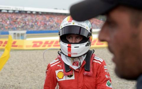 Ferrari driver Sebastian Vettel of Germany walks back to his pits after he crashed into the track wall during the German Formula One Grand Prix at the Hockenheimring racetrack in Hockenheim, Germany, Sunday, July 22, 2018 - Credit: ap