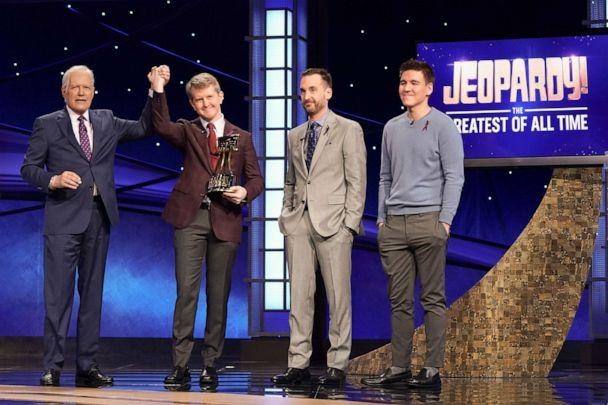 PHOTO: Jeopardy! Greatest of All Time tournament championship winner Ken Jennings raises his hand in victory alongside host Alex Trebek and fellow competitors, Brad Rutter and James Holzhauer. (Eric Mccandless/ABC via Getty Images, FILE)