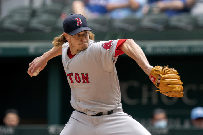 Boston Red Sox starting pitcher Garrett Richards works against the Texas Rangers during the first inning of a baseball game Sunday, May 2, 2021, in Arlington, Texas. (AP Photo/Jeffrey McWhorter)