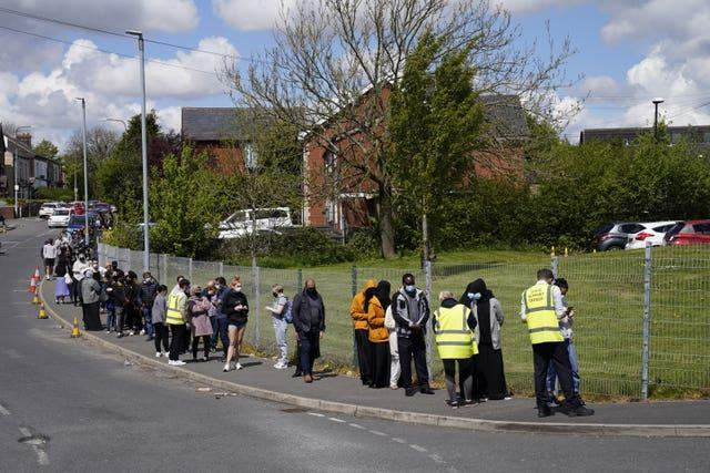People queuing for Covid vaccinations in Bolton