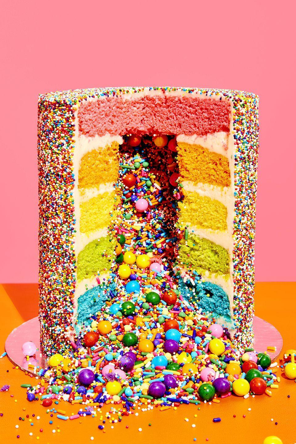 """<p>Flour Shop's Amirah Kassem's signature masterpiece: six layers of colorful cake hiding a tunnel of sprinkles that spill out in glorious fashion when it's sliced. You can make your own wowza work of art at home with the <a href=""""https://go.redirectingat.com?id=74968X1596630&url=https%3A%2F%2Fwww.williams-sonoma.com%2Fproducts%2Fflour-shop-surprise-cake-kit%2F&sref=https%3A%2F%2Fwww.womansday.com%2Ffood-recipes%2Fg36845030%2Fbirthday-cake-recipes%2F"""" rel=""""nofollow noopener"""" target=""""_blank"""" data-ylk=""""slk:Flour Shop Rainbow Explosion Cake Kit"""" class=""""link rapid-noclick-resp"""">Flour Shop Rainbow Explosion Cake Kit</a>, available at Williams-Sonoma.</p>"""
