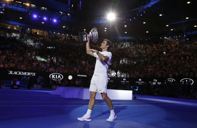 Tennis - Australian Open - Men's singles final - Rod Laver Arena, Melbourne, Australia, January 28, 2018. Winner Roger Federer of Switzerland does a victory lap with the trophy. REUTERS/Thomas Peter