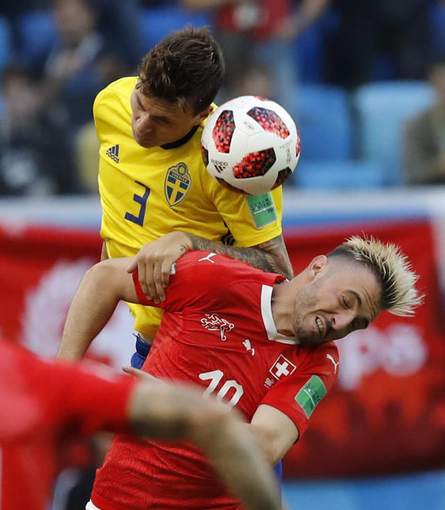 <p>Sweden's Victor Lindelof, left, heads for the ball with Switzerland's Granit Xhaka during the round of 16 match between Switzerland and Sweden at the 2018 soccer World Cup in the St. Petersburg Stadium, in St. Petersburg, Russia, Tuesday, July 3, 2018. (AP Photo/Efrem Lukatsky) </p>