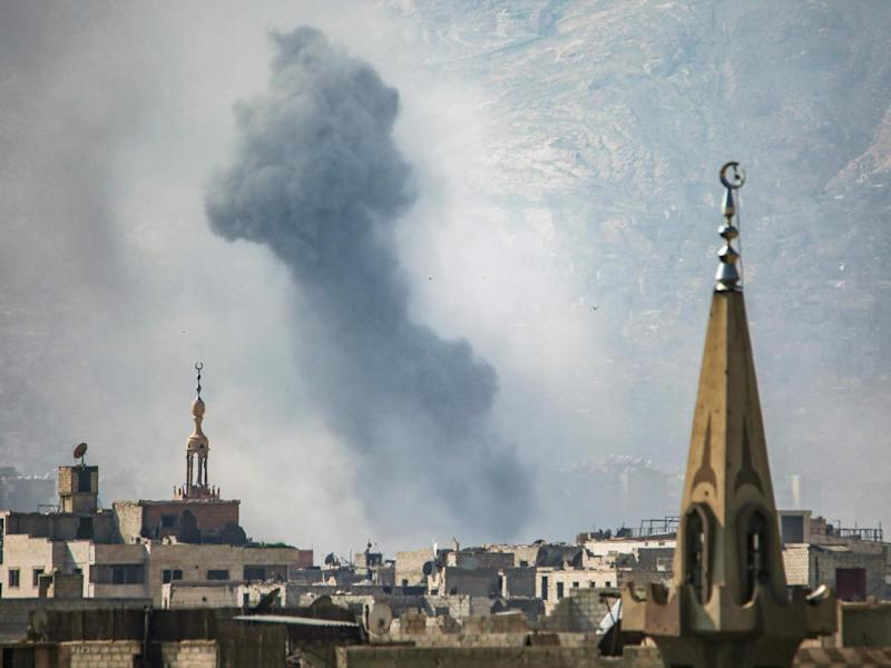 A general view shows moke rising from buildings following an air strike on Jobar, a rebel-held district on the eastern outskirts of Damascus (AFP/Getty)