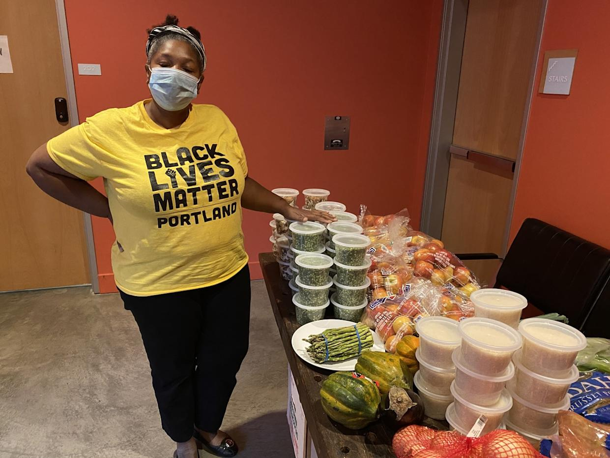 Rachelle Dixon, who heads Black Lives Matter in Portland, says her volunteers are giving out food, not smashing windows.