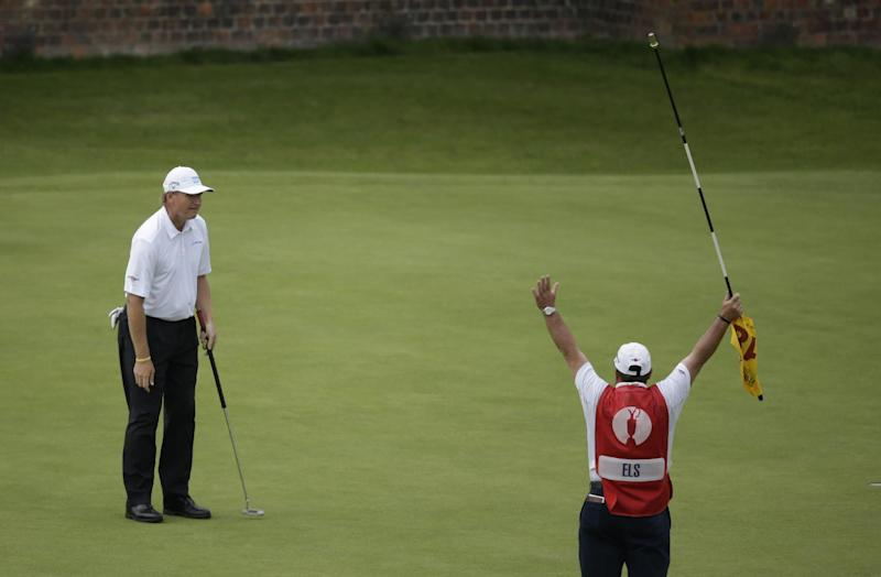 Ernie Els of South Africa reacts after putting on the 18th green with his caddie Ricky Roberts at Royal Lytham & St Annes golf club during the final round of the British Open Golf Championship, Lytham St Annes, England Sunday, July 22, 2012. (AP Photo/Tim Hales)