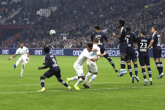 Marseille's Dimitri Payet shoots a free kick during the French League One soccer match between Marseille and Bordeaux at the Velodrome stadium in Marseille, southern France, Sunday, Dec. 08, 2019. (AP Photo/Daniel Cole)