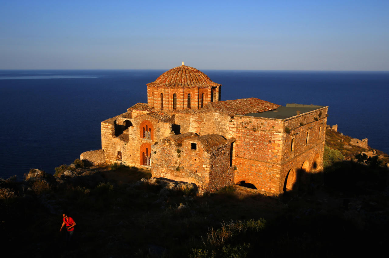A Belgian tourist walks atop the medieval fortress of Monemvasia in front of the 12th century church of Agia Sophia Yannis Behrakis / Reuters
