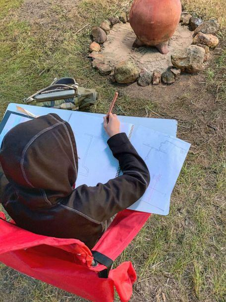 PHOTO: Lindsey Earle, a fourth grade teacher at Prairie Hill Waldorf School in Pewaukee, Wisconsin, built an outdoor structure for her 13 students amid the novel coronavirus pandemic. Here, one of Earle's students learns in her class. (Lindsey Earle)