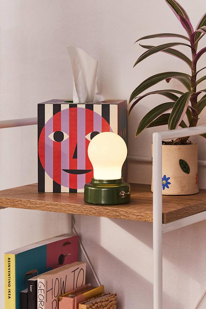 "If a lightbulb's constantly going off in your head, this lamp is for you. It's small enough to fit on a tiny desk and not <i>so</i> bright that you can't see your screen. <a href=""https://fave.co/2wOajRU"" rel=""nofollow noopener"" target=""_blank"" data-ylk=""slk:Find for $12 at Urban Outfitters"" class=""link rapid-noclick-resp"">Find for $12 at Urban Outfitters</a>. If this one's not to your taste, there's a <a href=""https://fave.co/2w19mWl"" rel=""nofollow noopener"" target=""_blank"" data-ylk=""slk:classic gold one"" class=""link rapid-noclick-resp"">classic gold one</a> on sale at Target, too."