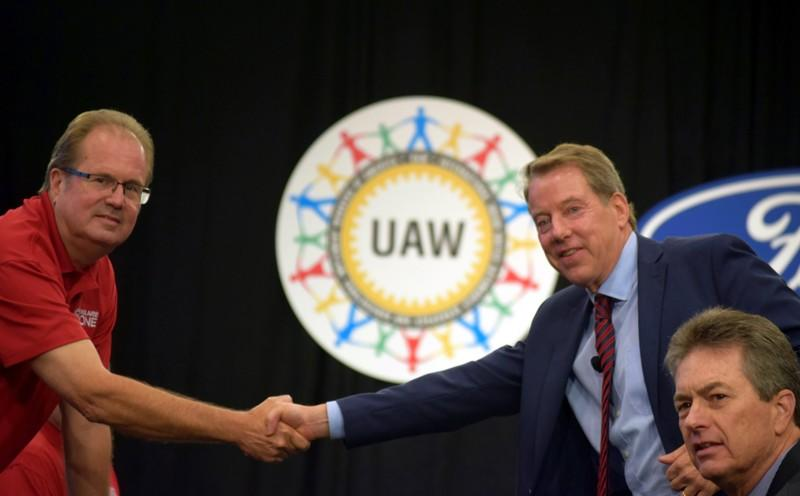 FILE PHOTO: UAW President Gary Jones shakes hands with Ford Motor Co Chairman Bill Ford at the start of contract talks between the union and the automaker in Detroit