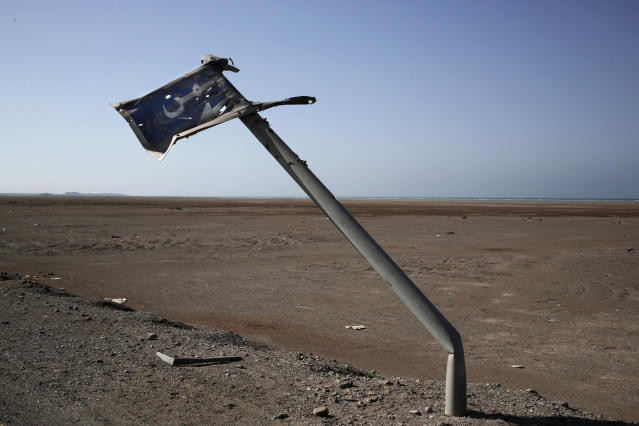 "<p>In this Feb. 12, 2018 photo, shows a damaged sign in Arabic that reads, ""Yemen,"" on the road from Aden to Mocha in Yemen. (Photo: Nariman El-Mofty/AP) </p>"