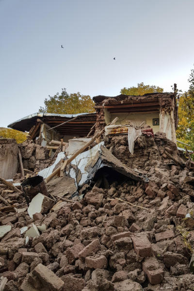 Debris lays amongst the ruins of collapsed buildings following an earthquake in Varankesh village in Eastern Azerbaijan province, some 250 miles (400 kilometers) northwest of the capital Tehran, Iran, Friday, Nov. 8, 2019. The temblor struck Tark county in Iran's Eastern Azerbaijan province early Friday.(Mohammad Zinali/Tasnim News Agency via AP)
