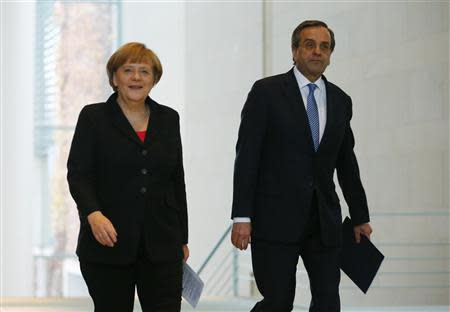 German Chancellor Angela Merkel (L) and Greece's Prime Minister Antonis Samaras arrive at a news conference after talks at the Chancellery in Berlin, November 22, 2013. REUTERS/Thomas Peter
