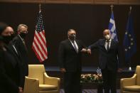 U.S. Secretary of State Mike Pompeo, left, and Greek Foreign Minister Nikos Dendias touch elbows during their meeting in the northern city of Thessaloniki, Greece, Monday, Sept. 28, 2020. Pompeo and Dendias, will sign a bilateral science and technology agreement, as well as host energy sector business leaders for a discussion to highlight energy diversification and infrastructure projects in Greece. (AP Photo/Giannis Papanikos, Pool)
