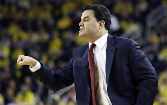 Arizona head coach Sean Miller directs his team from the sidelines during the first half of an NCAA college basketball game against Michigan in Ann Arbor, Mich., Saturday, Dec. 14, 2013. (AP Photo/Carlos Osorio)