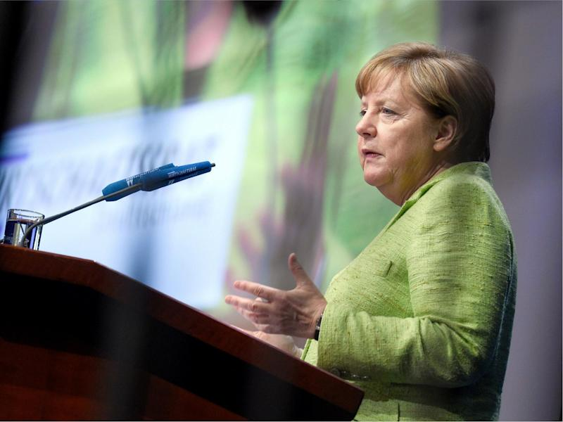 German Chancellor Angela Merkel speaks at a meeting of the Economic Council of the German Christian Democrats Party (CDU) on 27 June 2017 in Berlin: RAINER JENSEN/AFP/Getty Images