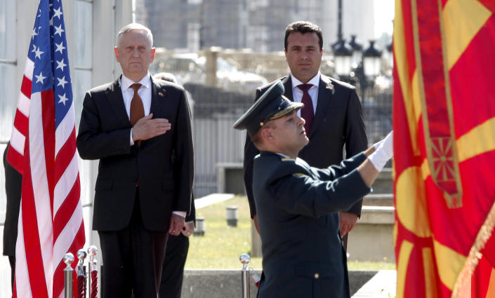 U.S. Defense Secretary James Mattis, left, and Macedonian Prime Minister Zoran Zaev, top right, observe the national anthems during a welcome ceremony at the government building in Skopje, Macedonia, Monday, Sept. 17, 2018. Mattis arrived in Macedonia Monday, condemning Russian efforts to use its money and influence to build opposition to an upcoming vote that could pave the way for the country to join NATO, a move Moscow opposes. (AP Photo/Boris Grdanoski)