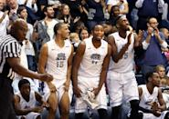 From left, Old Dominion's Deion Clark, Joe Ebondo and Jonathan Arledge celebrate during the final seconds of their team's win over Virginia Commonwealth during an NCAA college basketball game, Saturday, Nov. 29, 2014, in Norfolk, Va. Old Dominion won 73-67. (AP Photo/The Virginian-Pilot, Steve Earley)