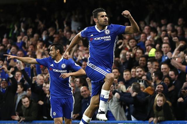 Chelsea's striker Diego Costa (R) celebrates with midfielder Pedro after scoring on May 8, 2017 (AFP Photo/Adrian DENNIS)
