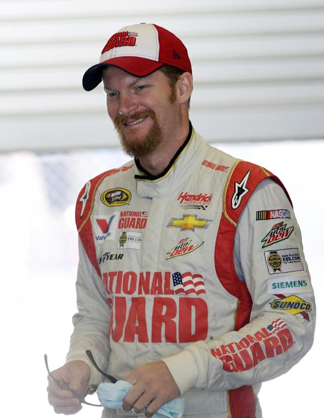 Driver Dale Earnhardt Jr. prepares to practice for the Brickyard 400 NASCAR Sprint Cup series auto race at the Indianapolis Motor Speedway in Indianapolis, Friday, July 25, 2014. (AP Photo/AJ Mast)