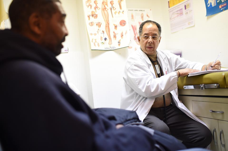 WASHINGTON, DC - DECEMBER 09: Dr. Edwin C. Chapman, right center, sees patient, Stanley Holt, left, who is being treated with a medication that contains buprenorphine and naloxone on Tuesday December 09, 2014 in Washington, DC.  The medication is used for an addiction to opiates. (Photo by Matt McClain/ The Washington Post via Getty Images)