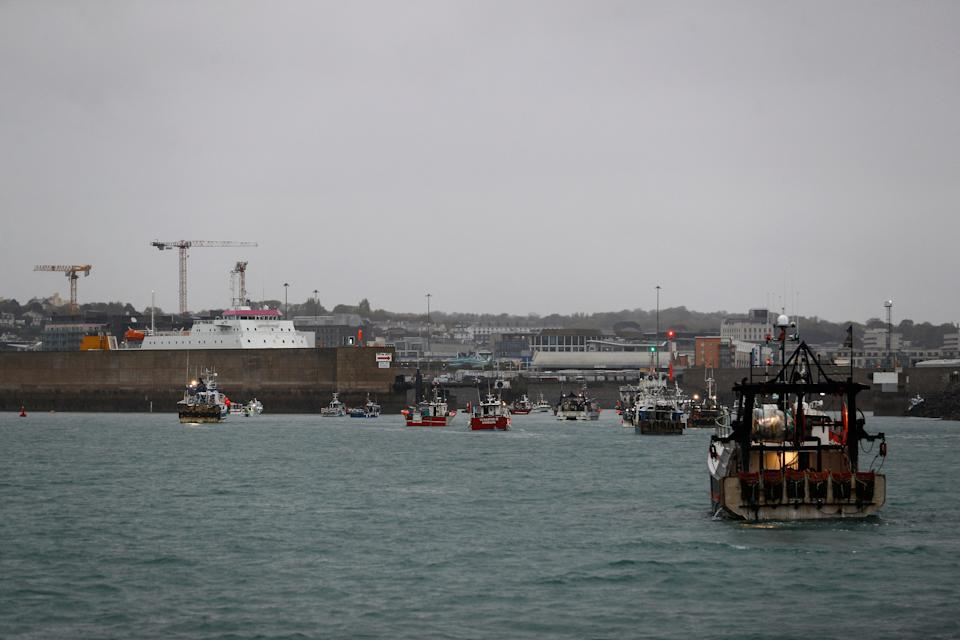 French fishing boats protest in front of the port of Saint Helier off the British island of Jersey to draw attention to what they see as unfair restrictions on their ability to fish in UK waters after Brexit, on May 6, 2021. - Around 50 French fishing boats gathered to protest at the main port of the UK island of Jersey on May 6, 2021, amid fresh tensions between France and Britain over fishing. The boats massed in front of the port of Saint Helier to draw attention to what they see as unfair restrictions on their ability to fish in UK waters after Brexit, an AFP photographer at the scene said. (Photo by Sameer Al-DOUMY / AFP) (Photo by SAMEER AL-DOUMY/AFP via Getty Images)