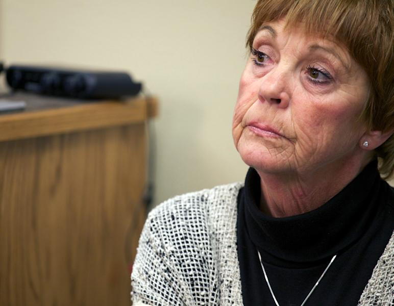 "Lynette Johnson, the wife of slain prison guard Ronald ""R.J."" Johnson, reacts as media witnesses describe to reporters the final moments of murderer Eric Robert, her husband's killer, on Monday, Oct. 15, 2012, in Sioux Falls, S.D. Robert and another inmate, Rodney Berget, killed Ron Johnson in April 2011 during a failed prison escape attempt. The Monday execution marked the first execution in five years and the second in more than half a century for the state. (AP Photo/Amber Hunt)"