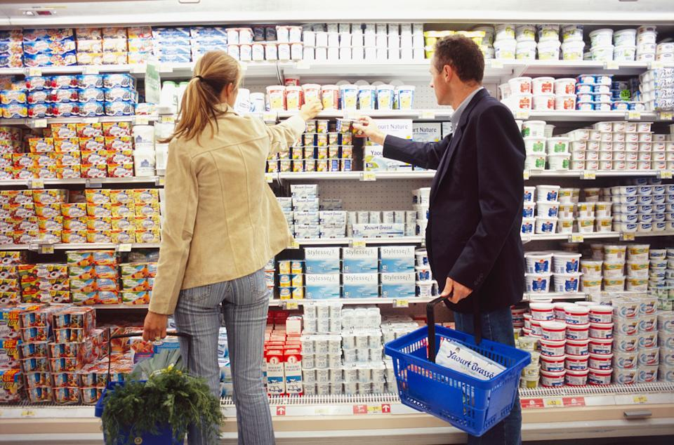 Man and Woman by Yogurts (Photo: Thierry Dosogne via Getty Images)