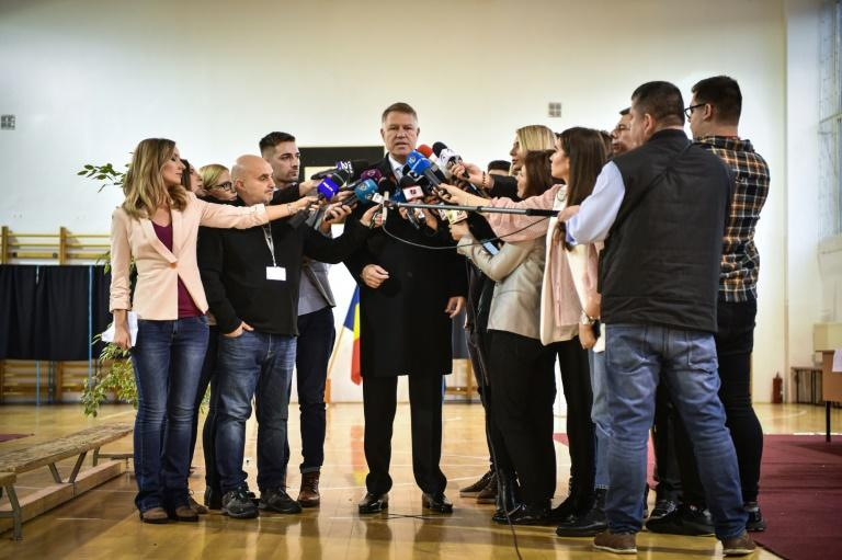 """I promise to be a president for all Romanians... A modern, European, normal Romania won today,"" a jubilant Iohannis said"