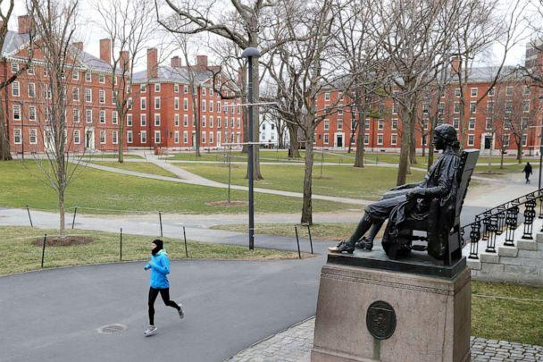 PHOTO: A runner crosses Harvard Yard on March 23, 2020 in Cambridge, Mass. (Maddie Meyer/Getty Images)
