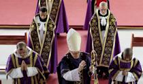 """French Bishop Jean-Michel Faure (C) walks during a mass in Nova Friburgo near Rio de Janeiro March 28, 2015. Two renegade Catholic bishops plan to consecrate a new generation of bishops to spread their ultra-traditionalist movement called """"The Resistance"""" in defiance of the Vatican, one of them said at a remote monastery in Brazil. French Bishop Jean-Michel Faure, himself consecrated only two weeks ago by the Holocaust-denying British Bishop Richard Williamson, said the new group rejected Pope Francis and what it called his """"new religion"""" and would not engage in a dialogue with Rome until the Vatican turned back the clock. Picture taken on March 28, 2015. REUTERS/Stephen Eisenhammer"""