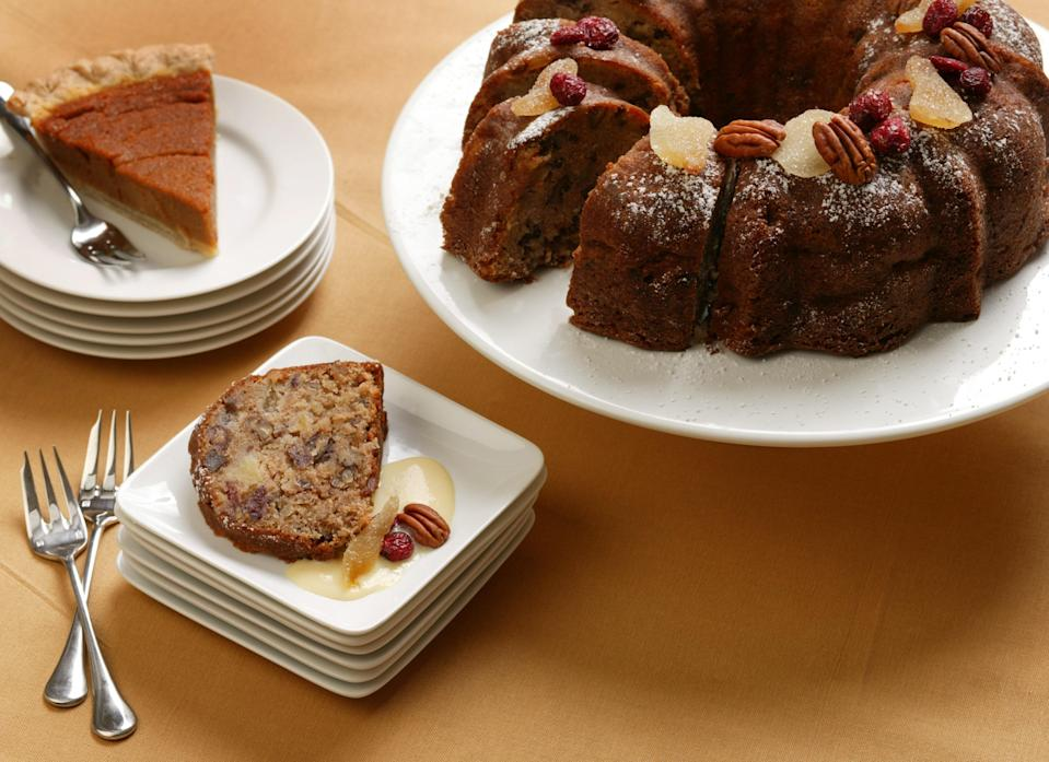 """A moist, deeply flavored confection studded with rum-soaked raisins and crunchy pecans, this streamlined one-bowl cake will get compliments even for novice bakers. Plus, it keeps for days. To dress up each serving, why not use store-bought eggnog, which has the consistency of custard sauce? <a href=""""https://www.epicurious.com/recipes/food/views/spiced-apple-cake-with-eggnog-sauce-240450?mbid=synd_yahoo_rss"""" rel=""""nofollow noopener"""" target=""""_blank"""" data-ylk=""""slk:See recipe."""" class=""""link rapid-noclick-resp"""">See recipe.</a>"""