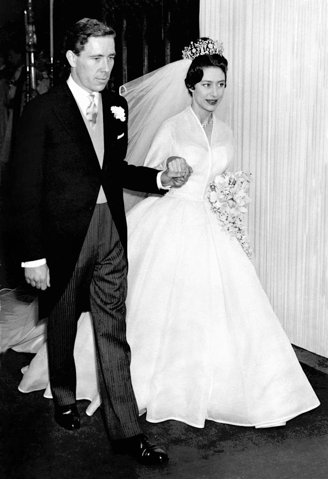 <p>Princess Margaret turned to Norman Hartnell – the same designer behind Queen Elizabeth's dress – for her 1960 wedding to Antony Armstrong. She finished the look with a diamond tiara. <em>[Photo: PA]</em> </p>