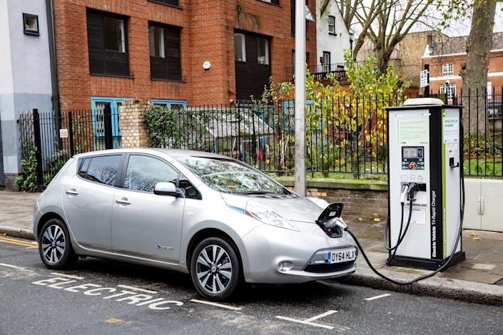 A Nissan Leaf being charged up on the streets on London.