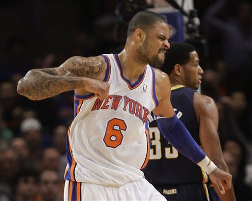 New York Knicks' Tyson Chandler (6) reacts as Indiana Pacers' Danny Granger (33) walks away during the first half of an NBA basketball game, Friday, March 16, 2012, in New York. (AP Photo/Frank Franklin II)