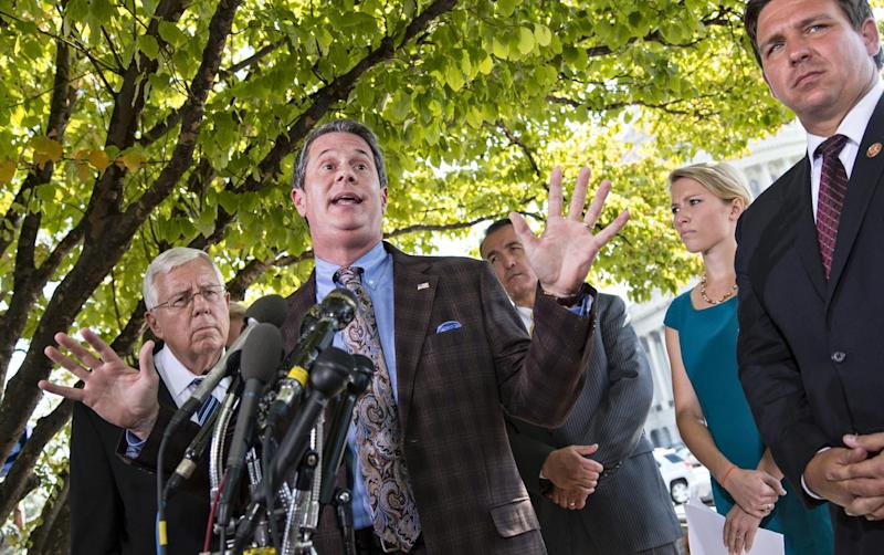 FILE - In this Sept. 30, 2013 file photo, Sen. David Vitter, R-La., speaks to reporters regarding the Affordable Health Care Act at the Capitol in Washington. Listening are from left, Sen. Mike Enzi, R-Wyo., Rep. Trent Franks, R-Ariz., Hadley Heath, of the Independent Women's Forum, and Rep. Ron DeSantis, R-Fla. Vitter will be a candidate in Louisiana's 2015 governor's race, announcing his decision Tuesday, Jan. 21, 2014 in an email to supporters. (AP Photo/J. Scott Applewhite, file)