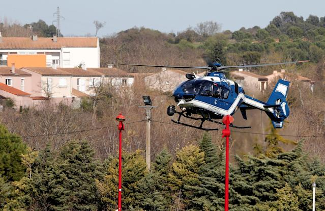 <p>A gendarmerie helicopter flies over the village of Trebes after a hostage situation in a supermarket, France, March 23, 2018. (Photo: Jean-Paul Pelissier/Reuters) </p>