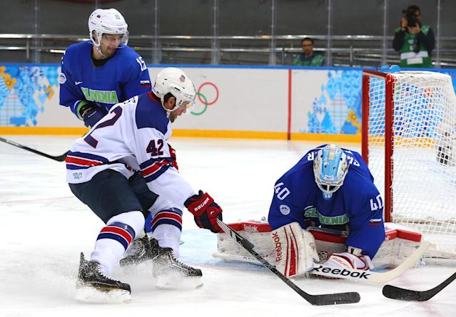 SOCHI, RUSSIA - FEBRUARY 16: Luka Gracnar #40 of Slovenia makes a save against David Backes #42 of the United States in the first period during the Men's Ice Hockey Preliminary Round Group A game on day nine of the Sochi 2014 Winter Olympics at Shayba Arena on February 16, 2014 in Sochi, Russia. (Photo by Martin Rose/Getty Images)