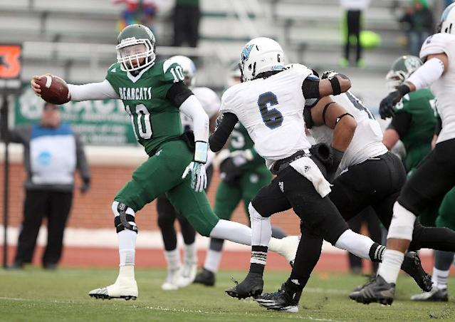 Northwest Missouri State University quarterback Brady Bolles scores a touchdown Saturday, Dec. 14, 2013 against Grand Valley State at Bearcat Stadium in Maryville, Mo. (AP Photo/St. Joseph News-Press, Jessica A. Stewart)
