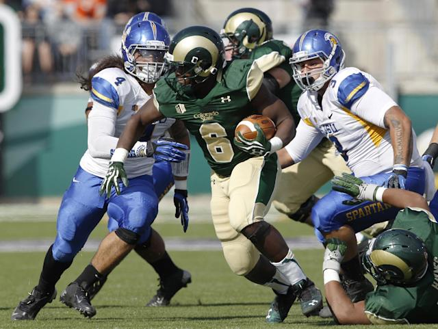 Colorado State running back Chris Nwoke, center, is pursued after a short gain by San Jose State linebacker Christian Tago, left, and defensive tackle Travis Raciti in the first quarter of an NCAA college football game in Fort Collins, Colo., on Saturday, Oct. 12, 2013. (AP Photo/David Zalubowski)