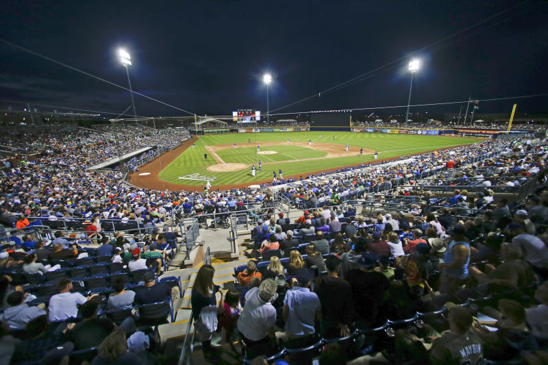 FILE - In this Thursday, March 12, 2015 file photo, Peoria Sports Complex Stadium host a spring training night baseball game between the San Diego Padres and Los Angeles Dodgers in Peoria, Ariz. Putting all 30 teams in the Phoenix area this season and playing in empty ballparks was among the ideas discussed Monday, April 6, 2020 during a call among five top officials from MLB and the players' association that was led by Commissioner Rob Manfred, people familiar with the discussion told The Associated Press. (AP Photo/Lenny Ignelzi, File)